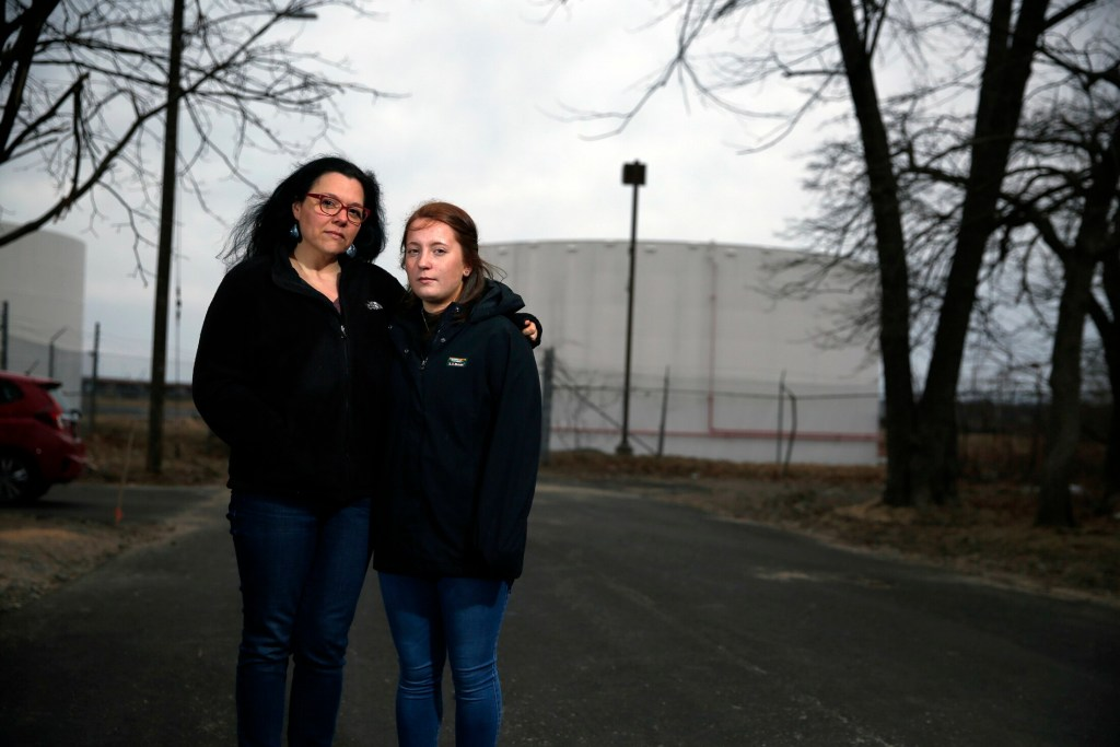 Kate Adamy, left, and her stepdaughter Ava Gleason live on Elm Street in South Portland's Pleasantdale neighborhood, where petroleum odors are worrying residents.