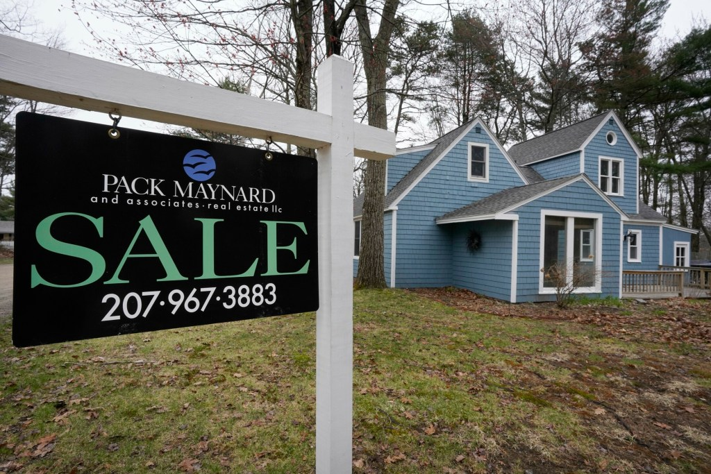 A for sale sign stands Monday in the yard of a home on Colby Lane in Kennebunk that has been on the market for 221 days. The number of home sales and the median sale price declined in March, indicating that Maine's upward real estate trend that has lasted nearly three years is over.