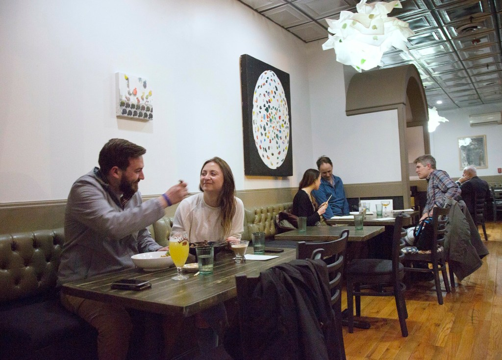 Tyler Rocheleau and Nicole DeMedio, both of South Portland, dine upstairs at N to Tail.