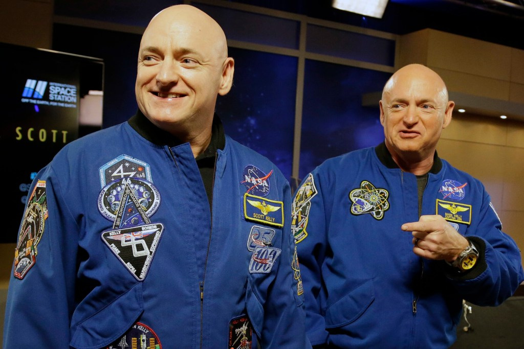 In this March 4, 2016 file photo, NASA astronaut Scott Kelly, left, and his identical twin, Mark, stand together before a news conference in Houston.