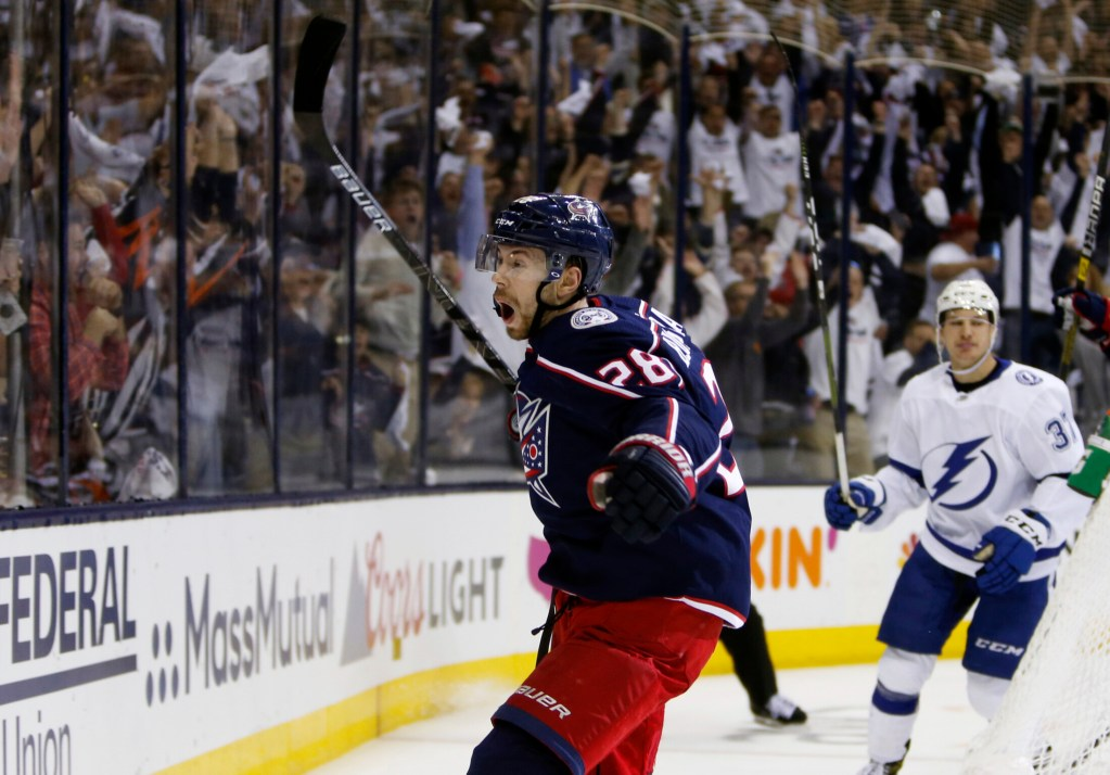 Columbus' Oliver Bjorkstrand celebrates his goal against the Tampa Bay Lightning during the second period of Game 4 Tuesday night at Columbus, Ohio.