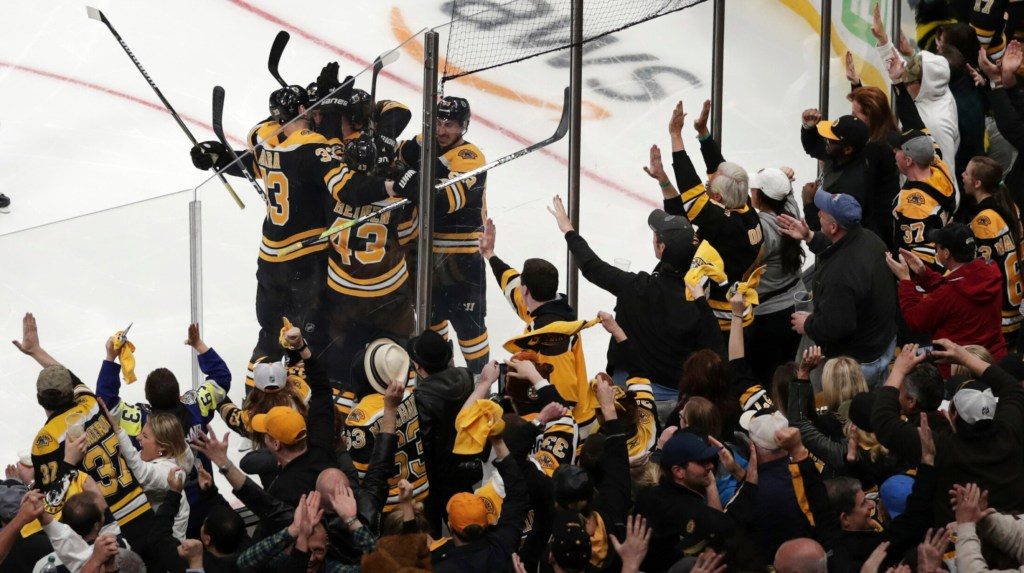 Bruins fans celebrate after a goal by Sean Kuraly, 52, in the third period Tuesday night against the Maple Leafs. Boston won Game 7, 5-1, to advance to the second round against Columbus.