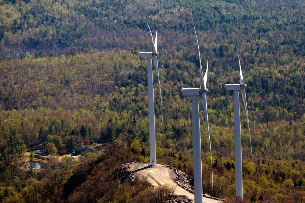 Three wind turbines stand atop a ridge just south of Webb Lake in this aerial photograph taken in 2015. A bill before lawmakers now would mandate increasing the percentage of electricity delivered to Maine consumers from renewable sources.