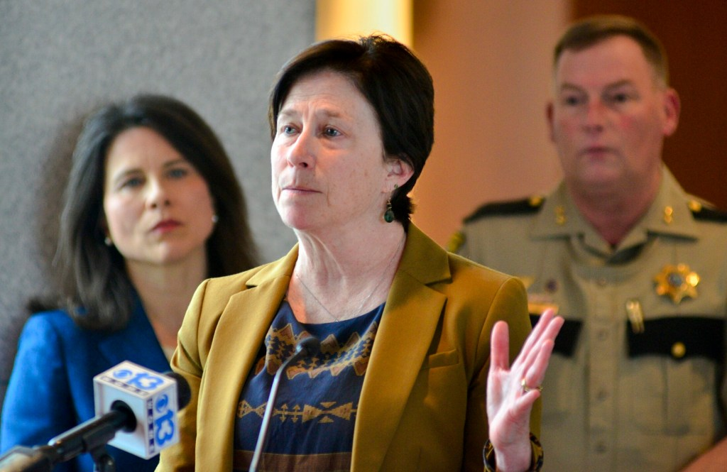 Superior Court Justice Michela Murphy talks during a news conference Thursday about criminal justice changes being made in Kennebec County. District Attorney Maeghan Maloney, left, and Kennebec County Sheriff Ken Mason, right, also spoke at the Capital Judicial Center in Augusta.