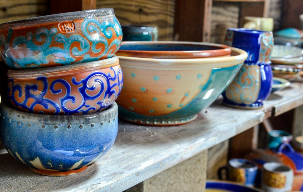 Some of Lori Watts' bowls sit on a shelf in her studio Saturday during a Maine Pottery Tour event at Fine Mess Pottery in Augusta.