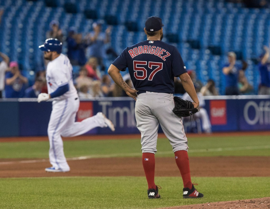 Red Sox starting pitcher Eduardo Rodriguez watches Toronto's Rowdy Tellez round the bases on a home run during the fifth inning of the Blue Jays' 10-3 win Tuesday in Toronto.