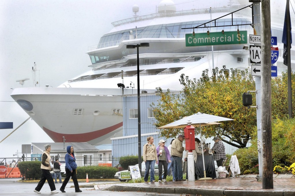 Passengers unload from the Norwegian Dawn (in background) at the Maine State Pier in  Portland in 2012. The ship was the first to visit Portland this cruise season.