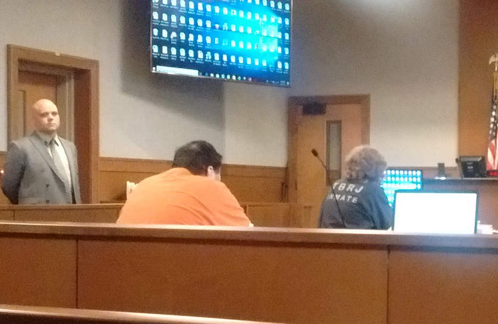 Julio and Sharon Carrillo await the arrival of attorneys Thursday at the Waldo Judicial Center.