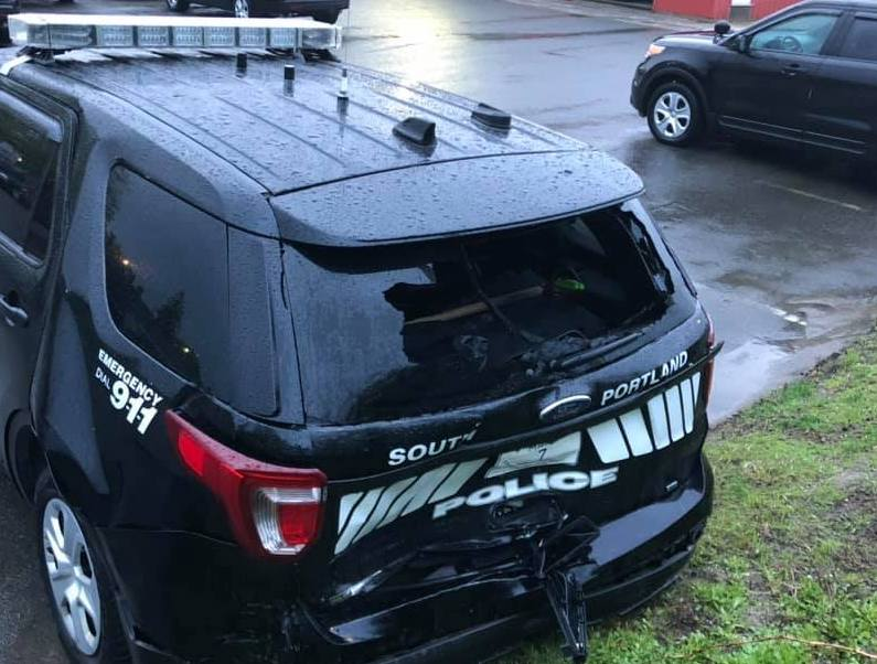 This South Portland police cruiser was struck while parked on 1-295 on Saturday night.
