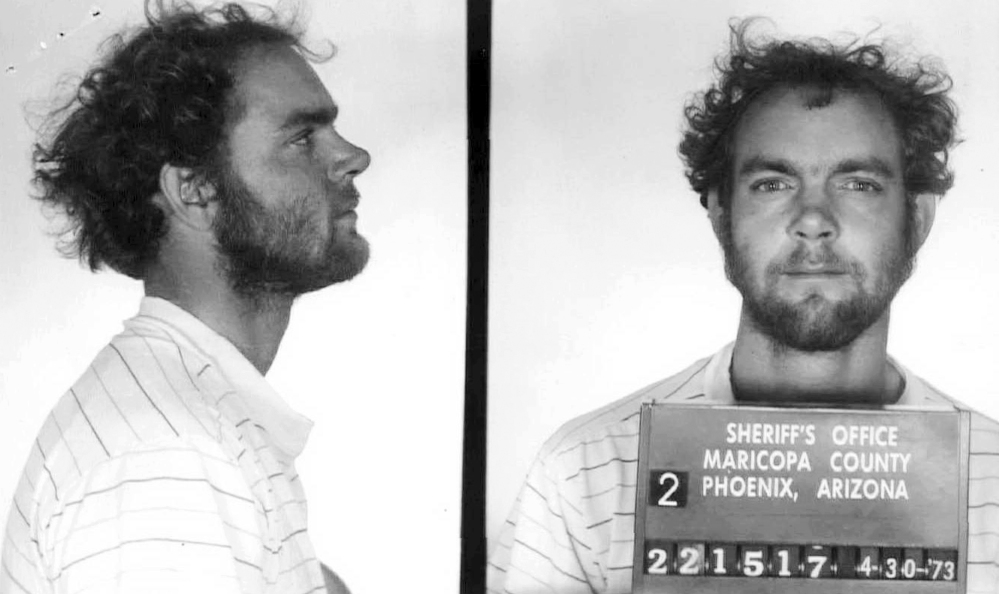 This 1973 booking photo from Arizona shows Terry Peder Rasmussen. Authorities want to learn about a woman he was seen with in the 1970s, saying she may be the mother of one of the young girls whose bodies were found in barrels near a New Hampshire state park in 1985 and 2000.
