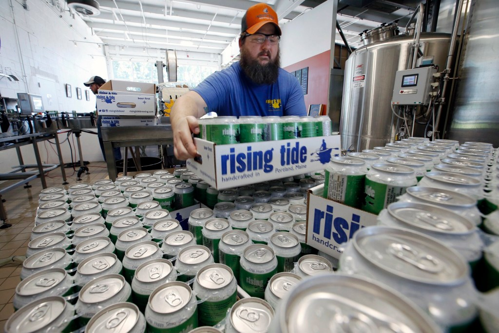 Merritt Waldron, director of quality control at Rising Tide Brewing Company stacks a case of MITA on a growing pallet. C&R Research named Portland the No. 1 city in America for number of craft breweries per 50,000 people. .