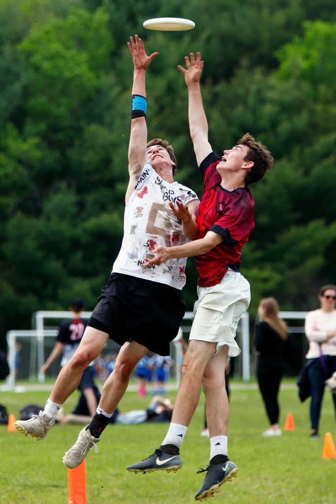 NEW GLOUCESTER, ME - JUNE 1: Cape Elizabeth's Calvin Stoughton, left, makes a scoring catch despite pressure from Cumberland's Aidan Hayes during the high school Ultimate state championship game at New Gloucester Fairgrounds on Saturday. Cape Elizabeth bested Cumberland 15-3 to earn the title. (Staff photo by Ben McCanna/Staff Photographer)
