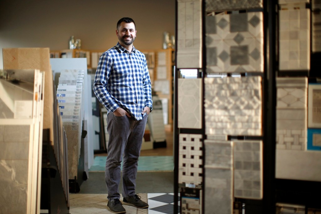 Joe Capozza III, president of Capozza Tile & Flooring, poses in the showroom of his family business. His family has tapped the services of the Institute for Family-Owned Business to ensure a professionally run company.