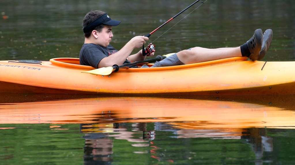 Eric Croteau, 15, casts for fish while kayaking on Wilson Pond in Monmouth last year. New federal data show nearly 5 percent of Maine's economy can be attributed to outdoor recreation.