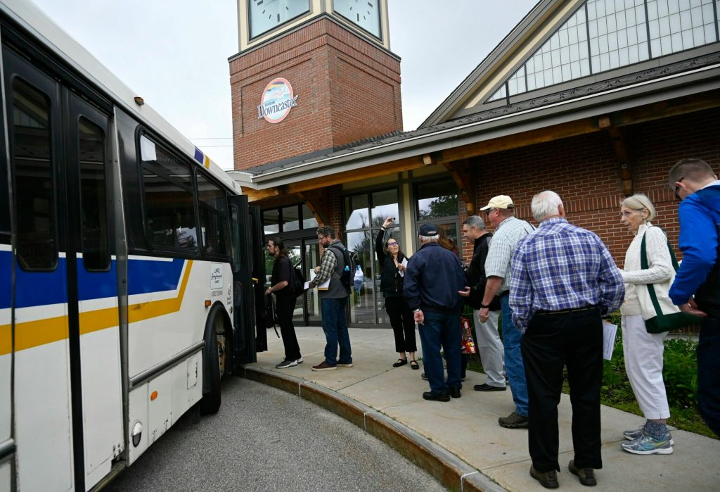 Regional transit leaders and elected officials board a bus to compete Friday in the Stupendous Tournament of Transit.