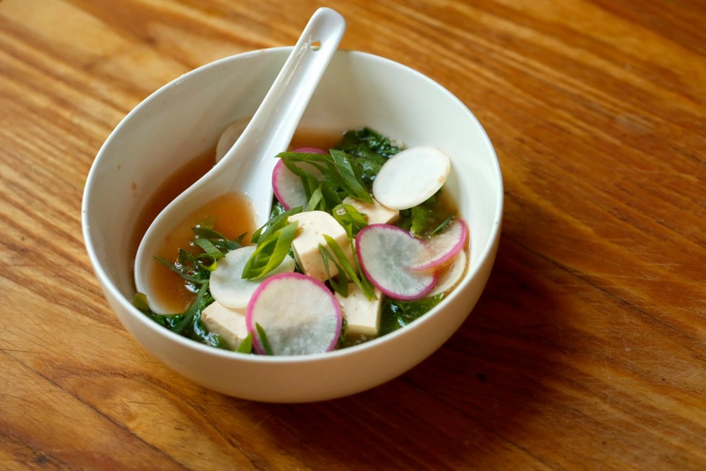 Ginger-Garlic Miso Soup uses both radish (or turnip) greens and roots.