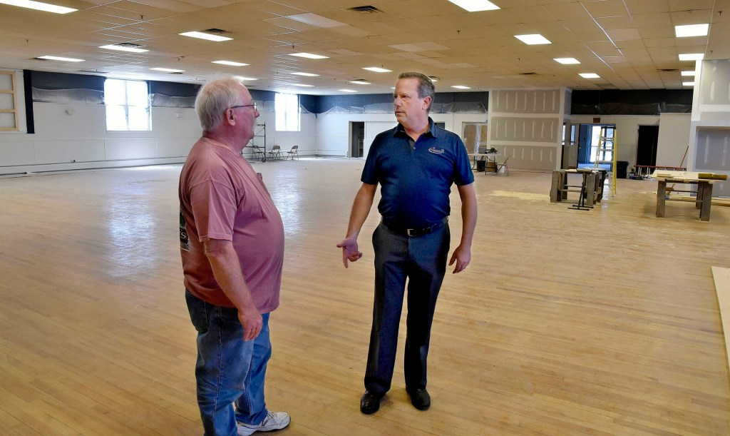 Bill Mitchell, owner of the former American Legion building in Waterville, speaks with property manager Jay Conway on June 24. Mitchell plans to renovate the large space on College Avenue into an events center called The Elm.
