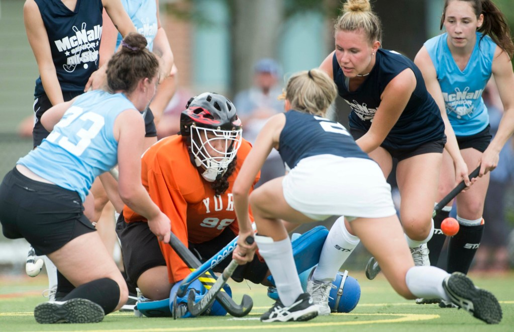 South goalie Julianna Kiklis (98) of York protects the goal as South's Paige Laverriere (2) of Biddeford defends while North's Kaitlyn Smith (23) of Messalonskee tries to score in the McNally All-Star game Saturday at Thomas College in Waterville.
