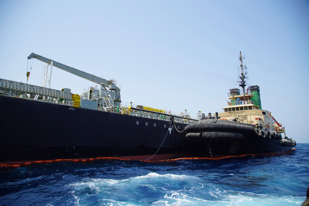 """The Japanese-owned oil tanker Kokuka Courageous, which the U.S. Navy says was damaged by a mine, is anchored off Fujairah, United Arab Emirates, during a trip organized by the Navy for journalists Wednesday. The limpet mines used to attack the oil tanker near the Strait of Hormuz bore """"a striking resemblance"""" to similar mines displayed by Iran, a Navy explosives expert said. Iran has denied being involved."""