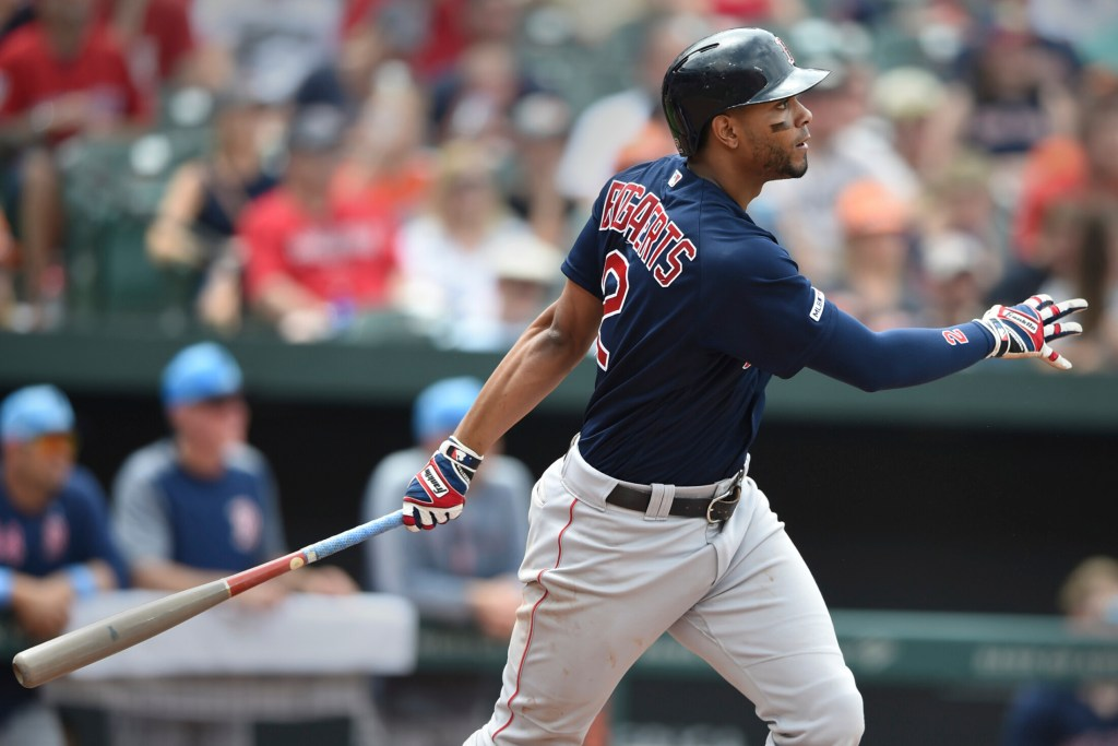Xander Bogaerts follows through on a RBI double in the fourth inning of Boston 8-6 win over the Baltimore Orioles on Saturday in Baltimore.
