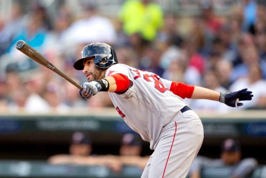 Boston's J.D. Martinez hits and RBI single in the first inning against the Minnesota Twins on Monday in Minneapolis.