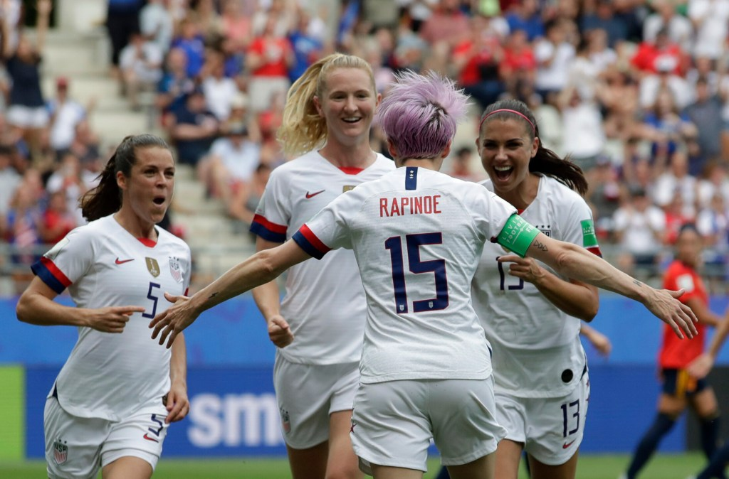 Megan Rapinoe of the United States, front, celebrates with teammates after scoring the opening goal from a penalty kick during Monday's Round of 16 win over Spain at the women's World Cup.