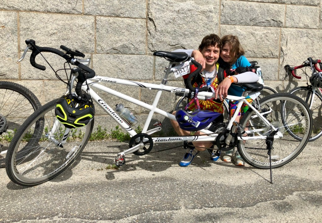 Bryan and Maggie McCarthy pose with their tandem bicycle at the Augusta Waterfront Park on Sunday, the third day of the Trek Across Maine.