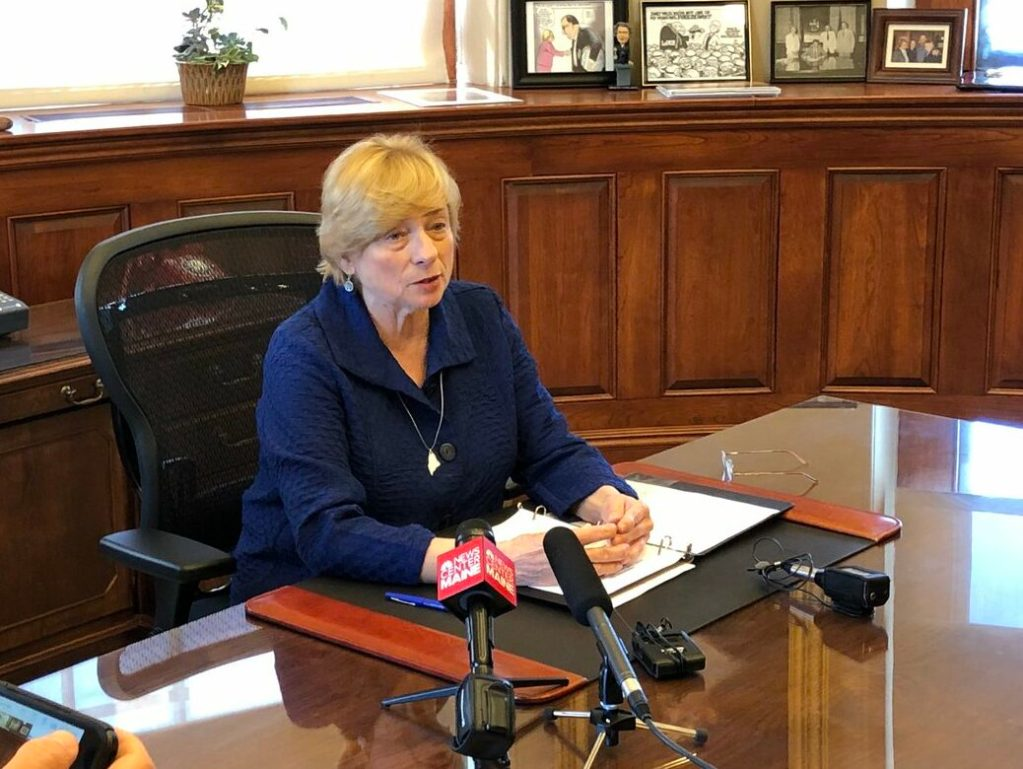 Gov. Janet Mills signs the bill Wednesday to allow terminally ill patients to be prescribed a lethal dose of medication.