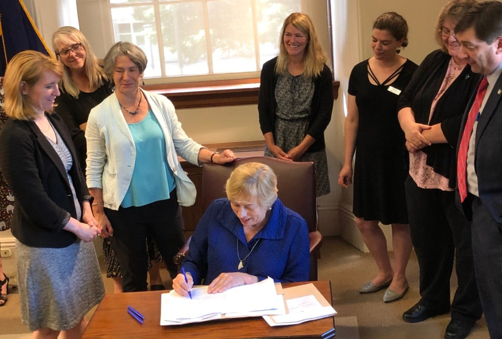 Gov. Janet Mills signs bills into law recently at the State House.