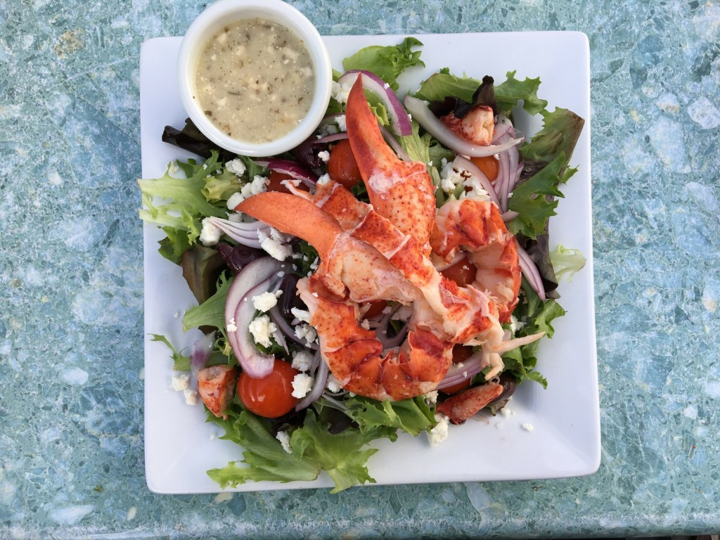 The Greek salad at The Bait Shed in Scarborough is loaded with feta and kalamata olives, a treat in itself. But add lobster and it's a full meal. The view - even at low tide - is a peaceful, wild experience. Photo by Staff Writer Deirdre Fleming
