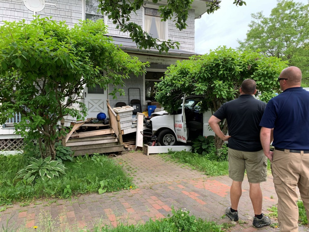 A van struck the porch of a building in Portland Tuesday morning.