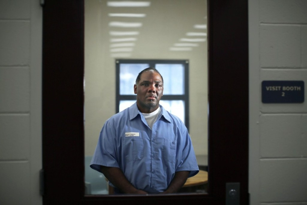Foster Bates is shown earlier this year in a visiting room at the Maine State Prison in Warren. Bates has been serving a life sentence since he was convicted in 2002 of raping and murdering a South Portland woman. He has maintained his innocence from the start and pushed for a new trial.
