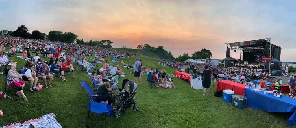 In this panorama photo, people listen to the Portland Symphony Orchestra's performance on the Eastern Prom before the fireworks display on Thursday night.