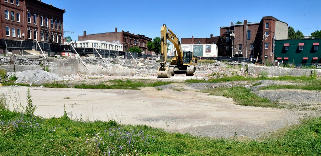 An excavator moves into the site for the new Lockwood Hotel in downtown Waterville on Monday.