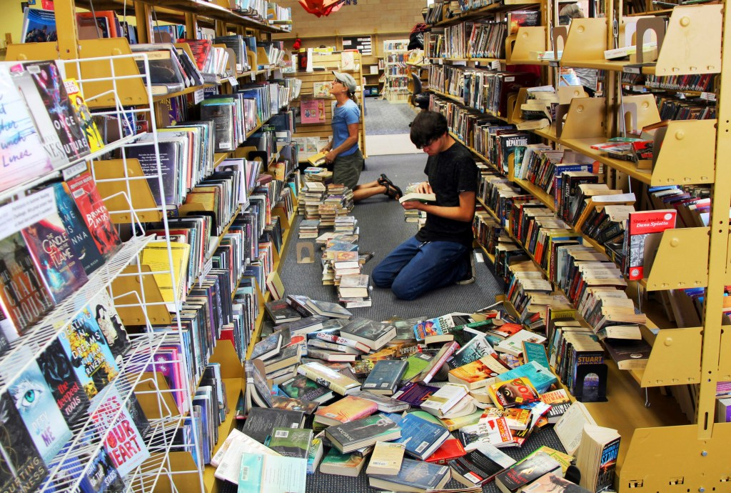 Volunteers assist with cleanup Friday at the Ridgecrest, Calif., branch of the Kern County Library, following a 6.4 magnitude earthquake that shook the region about 150 miles northeast of Los Angeles Thursday. The region was hit by an even stronger earthquake Friday evening.
