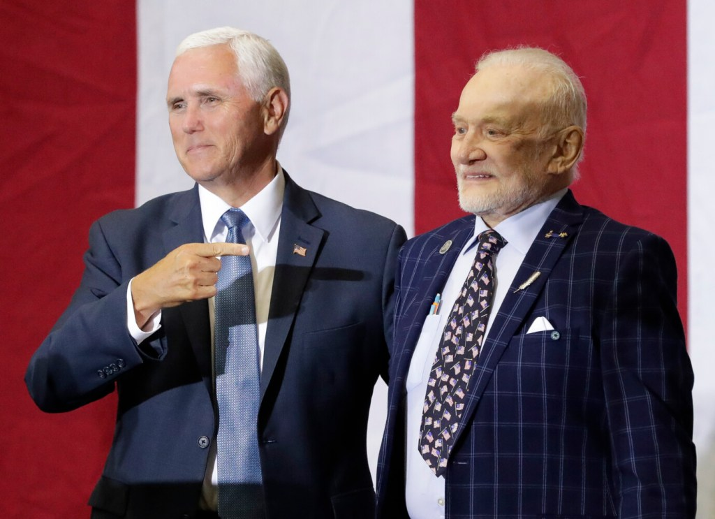 Vice President Mike Pence, left, celebrates with Apollo 11 astronaut Buzz Aldrin during an event at the Kennedy Space Center in recognition of the launch's 50th anniversary, Saturday in Cape Canaveral, Fla.