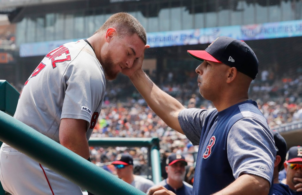 Christian Vazquez is greeted by Manager Alex Cora after a two-run home run during Boston's 6-3 win over the Detroit Tigers on Sunday in Detroit.