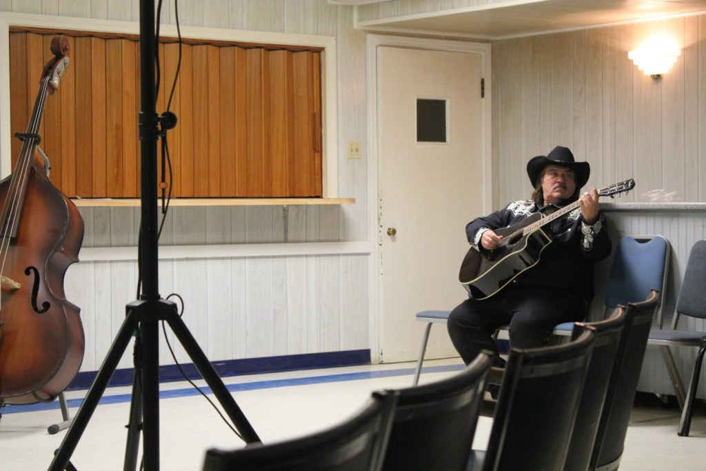 """Jeff Simon, one of the state's country music hall of fame inductees, warms up on the guitar before a performance for a live taping of """"Maine's Down Home Country Jamboree"""" Sunday night at the old Waterville Legion building on College Avenue. Simon used to perform on """"Dick Stacey's Country Jamboree,"""" which the new show is based off of, in the 1970s and '80s."""