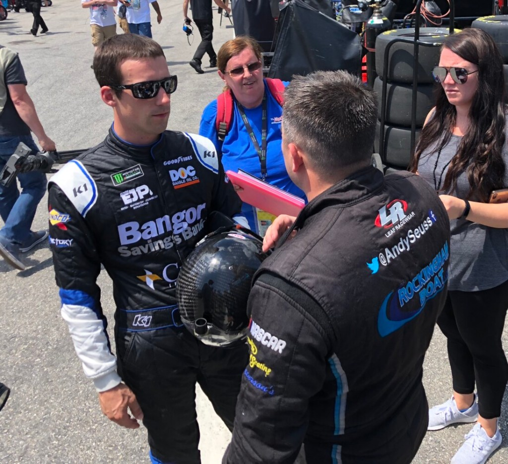 Austin Theriault, left, talks with Rick Ware Racing teammate Andy Seuss following Monster Energy NASCAR Cup Series practice at New Hampshire Motor Speedway in Loudon, N.H., on Friday.