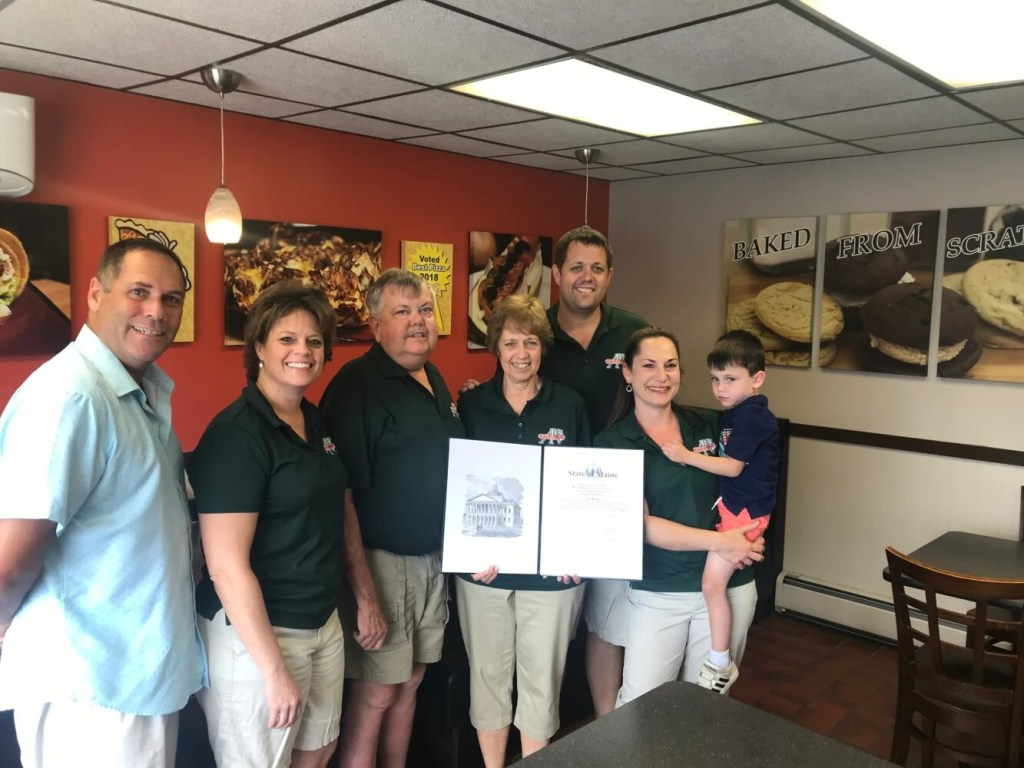 Three generations of the Partridge family pose Saturday with a legislative sentiment from the Maine Senate, recognizing Al's Pizza in Skowhegan for it's 50th anniversary in business. The family has owned the business since 1969, and has been in the current location at 20 Waterville Road since 1987.