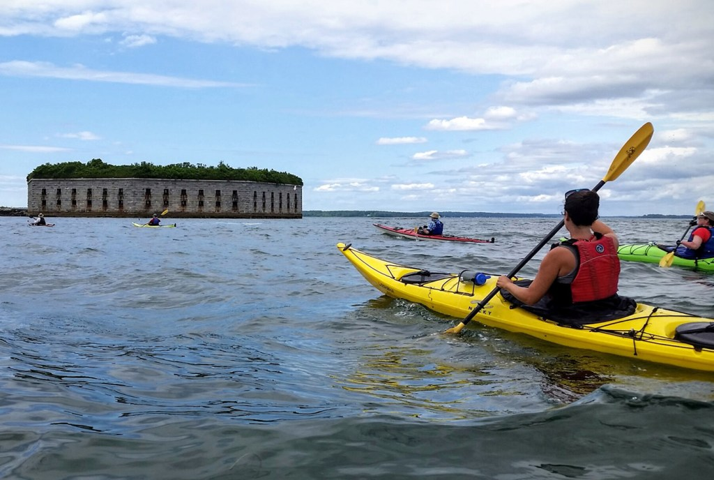 Kayakers make their way to Fort Gorges.