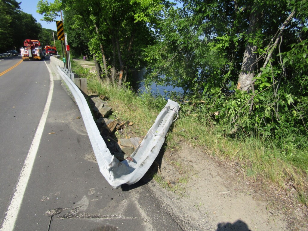 A bent guardrail near the Litchfield/West Gardiner line gives evidence of a crash that sent a 2005 Pontiac G6 and its driver into Cobbosseecontee Stream.