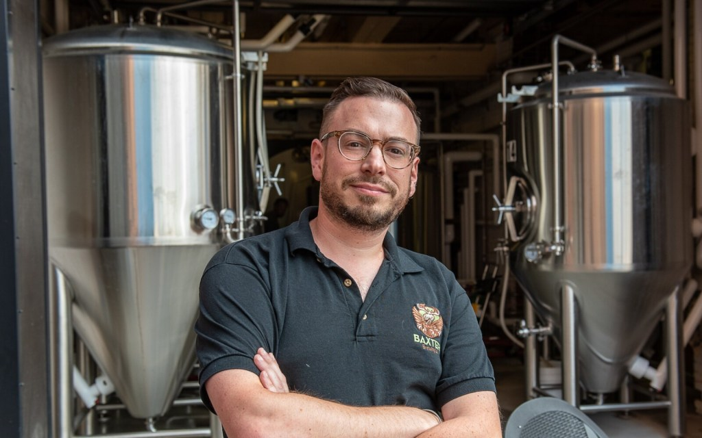 Baxter Brewing Co. founder Luke Livingston, at The Pub in Lewiston on Monday, announced that he's retiring from the company next month.
