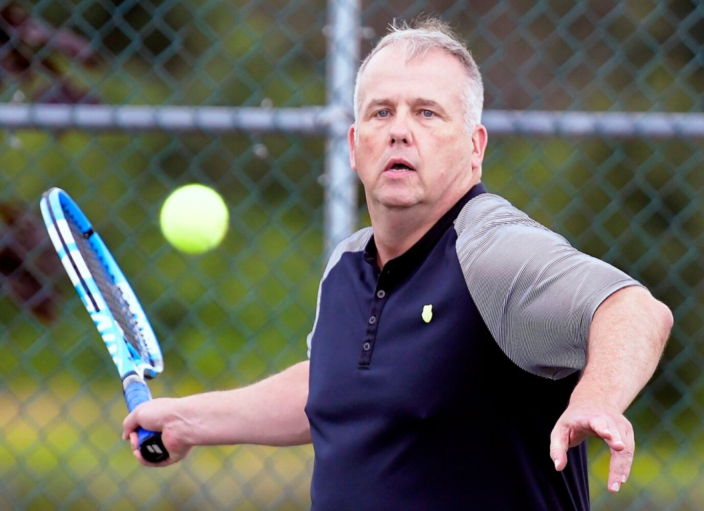 Ken Wells hits balls with his partner, Mark Gelsinger, near their home in Gardiner. on Tuesday.