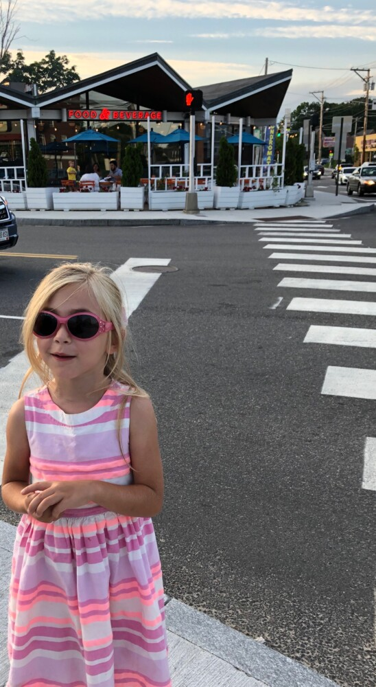 Is six-year-old Margaux Boger wearing sunglasses so Woodford Food & Beverage won't know she is coming to critique them?