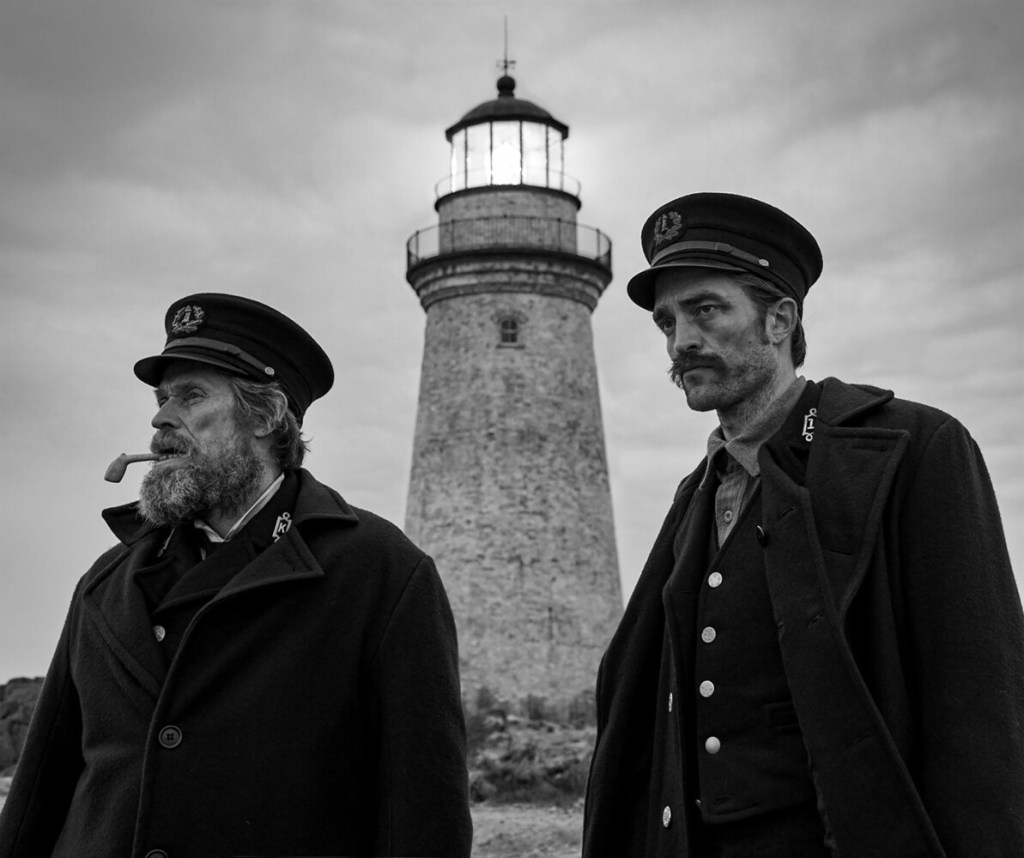 "Robert Pattinson, left, and Willem Dafoe in a scene from ""The Lighthouse."""