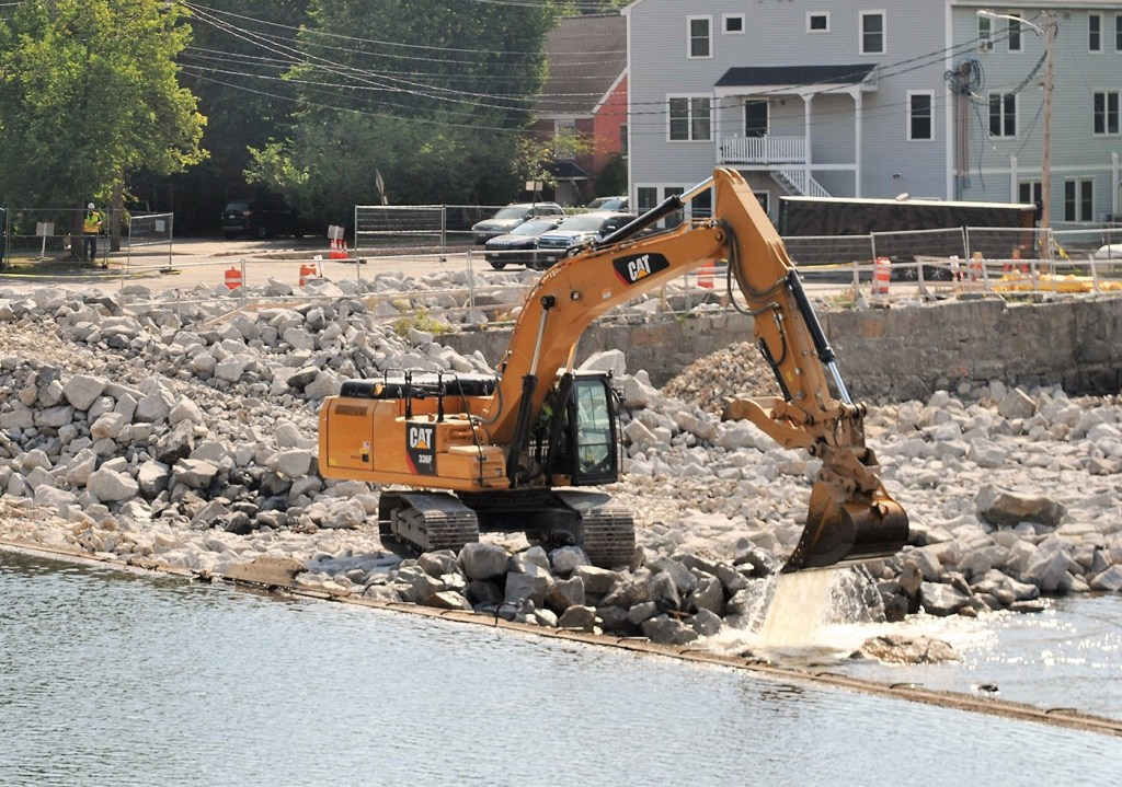Work is performed on Wednesday on the Springs Dam in Saco.