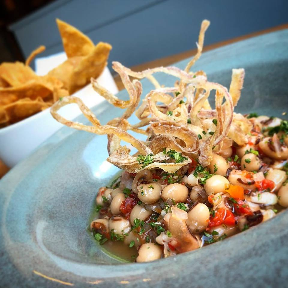 The black-eye pea escebech at Sur Lie often appears on vegan tasting menus at the Portland restaurant. You can find multi-course vegan tasting menus at a number of restaurants here.