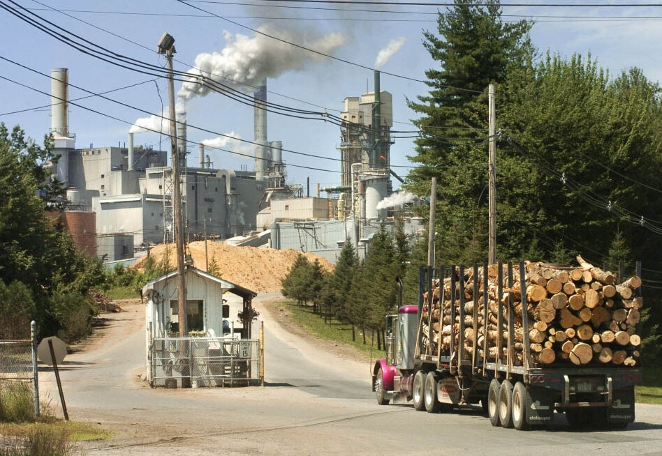 Logs are delivered to the Androscoggin Mill in Jay in 2005. Former owner Verso Corp. said Monday that it has sold the mill to a Pennsylvania company, Pixelle Specialty Solutions.
