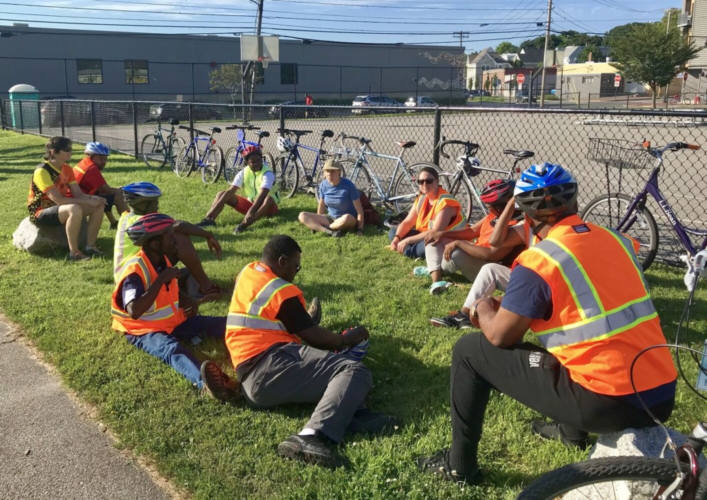 The Bikes for All Mainers class gets ready to ride July 18 at Kennedy Park in Portland. The program, which has a special outreach to new Mainers, teaches bike safety and responsibility, and allows participants to earn a bike at the end of the course.